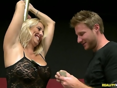 This sexual blond milf was showing the guys the location for the charity poker tournament, and she used the excuse to do a little dance routine on the pole. And thats just the start...