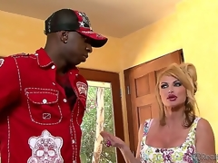 Taylor Wane and her hubby Gabriel Dalessandro were in the middle of having lunch when the doorbell rang. It was Jon Jon, and she shamelessly started sucking his darksome cock right there!